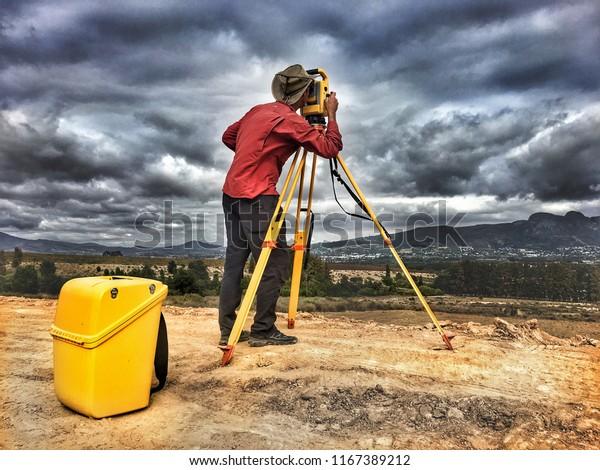 Land Surveyor Looking Through Trimble Robotic Stock Photo (Edit Now