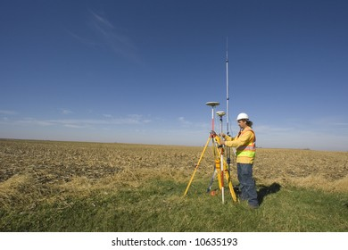 Land surveyor working with GPS unit.
