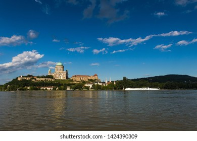 Landcsape with Basilica of Esztergom placed on the hill over the Danube river  in Hungary under the blue cloudy sky on a sunny day