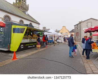 Landeda, France - August 14 2018: On a grey and damp morning few people are shopping in the Landeda street market.
