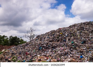 Landfill With Cumulus Clouds, landscape with garbage dump