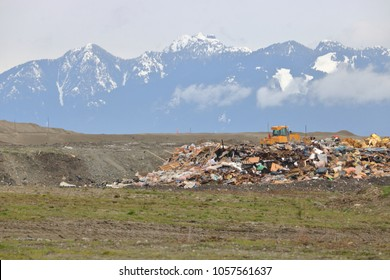 A landfill garbage dump overlooks Vancouver, Canada's North Shore mountains during the winter months.