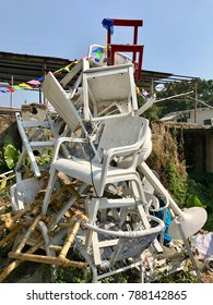 A landfill that fill full of chairs