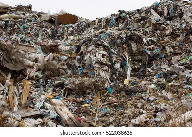 Landfill in Ukraine, piles of plastic dumped in piles. The roads along inorganic waste jumble, Air, ground pollution. Lviv
