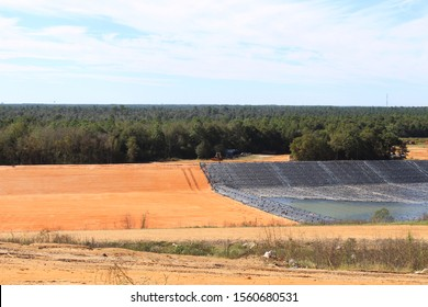 Landfill using geomembrane cap. Empty space left for words.