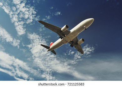 landing of an airplane in international airport, blue sky
