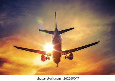 Landing Airplane and the Sun. Air Travel and Transportation Photography Concept.