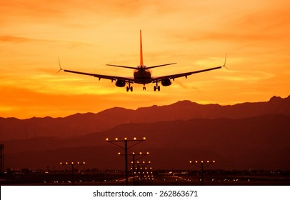 Landing Airplane at Sunset. Las Vegas International Airport, Nevada, United States. Air Transportation Theme.