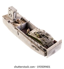 a landing craft plastic model  with a tank isolated over a white background