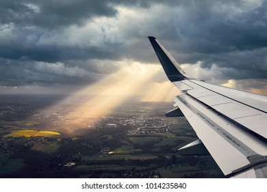Landing during wind storm. View from the airplane window on the dramatic sky.