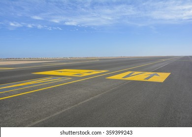 landing light Directional sign markings on the tarmac of runway at a commercial airport