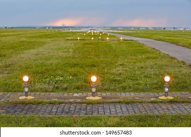Landing lights - The storm is approaching the airport.