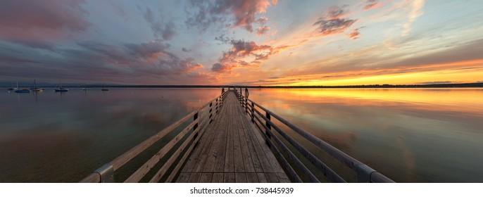 Landing pier at sunset at Lake Ammersee, Breitbrunn, Bavaria, Germany