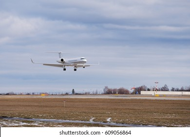 Landing of the private passenger biz jet or business jet airplane at Vaclav havel airport in Prague, capitol of Czech Republic in the winter summer day.