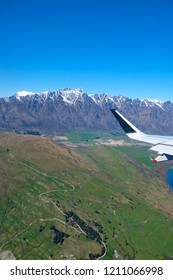 Landing at Queenstown New Zealand, aerial view. The Remarkables moutains in the background
