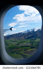 Landing at Queenstown New Zealand's South Island, aerial view from commercial airplane