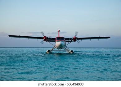 Landing seaplane in the lagoon