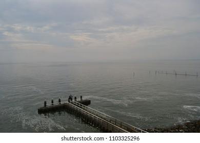 "Landing stage on the dutch dike ""Afsluitdijk"" which divides ""Ijsselmeer"" and north sea, Netherlands, 8-26-2017"