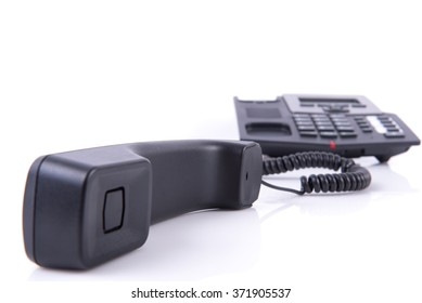 Landline off the hook on white background