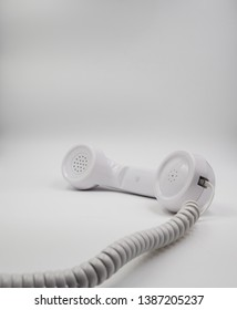 Landline telephone headset, isolated, with wire. Studio lights, closeup view
