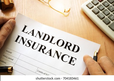 Landlord insurance on a desk.