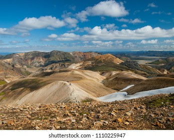 Landmannalaugar area - popular hiking trail. Colorful mountains with goup of backpackers.