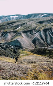 LANDMANNALAUGAR, ICELAND - AUGUST 21,2014:  Man in a mountain hike in Iceland.