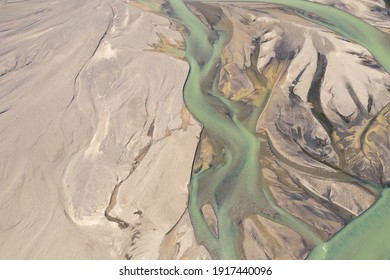 Landmannalaugar National Park - Iceland. Rainbow Mountains. Aerial view of beautiful colorful volcanic land, rivers and hot springs. Top view.