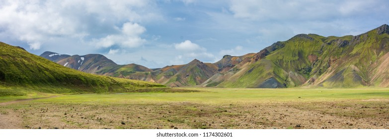 Landmannalaugar, or the 'People's Pools', a vast area of stunning beauty in the heart of Iceland's southern Highlands with colorful lava and sand formations, snow, and beautiful hiking trail