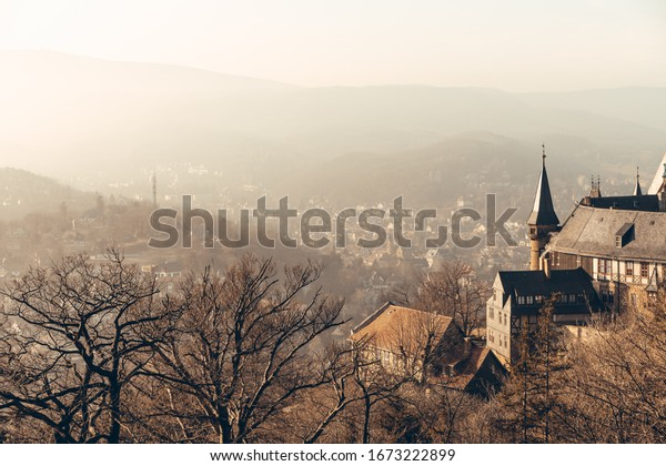 The landmark castle overlooking the old town of Wernigerode in the Golden light of the sun