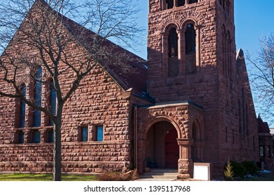 landmark church at corner and bell tower above entrance of richardsonian romanesque style architecture in saint paul minnesota