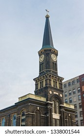 landmark church facade with bell tower and steeple in downtown milwaukee wisconsin