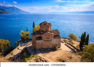 Landmark of church St. Jovan Kaneo, Ohrid. Lake, clouds, mountains in background.