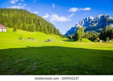 Landmark of italian mountain region in spring for fridge magnet.