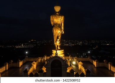 The landmark of Nan in Thailand, a large monument located on the mountain overlooking the city.  And light during the evening