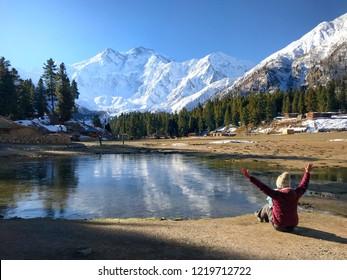 "The landmark of Pakistan. Women sit enjoy beauty peak of""Nanga Parbat Mountain""The 9th world's  highest peak also known as""Killer Mountain"". beautiful landscape in northern area Pakistan."