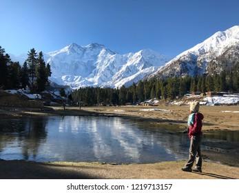 "The landmark of Pakistan. Women standing enjoy beauty peak of""Nanga Parbat Mountain""The 9th world's  highest peak also known as""Killer Mountain"". beautiful landscape in northern area Pakistan."