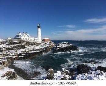 The landmark Portland head light located on Cape Elizabeth Maine after a winter storm.