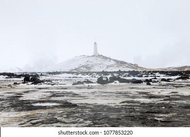 The landmark Reykjanes Lighthouse shrouded in the mist