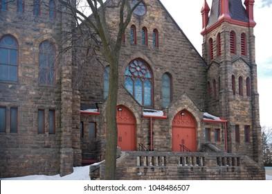 landmark romanesque style church entrance and facade in east phillips neighborhood of minneapolis minnesota