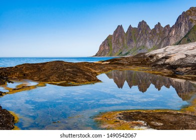 The landmark in Senja National Scenic Route with its reflection in summer day.