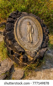 landmark sign of David Livingstone on an island above the Victoria falls close to the town Livingstone in Zambia