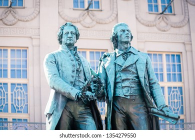 Landmark of Weimar town. Famous sculpture of Goethe and Schiller in the Weimar, Thuringia, Germany