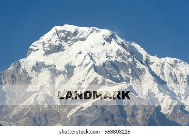 LANDMARK word over the background of the mountain. Concept for self belief, challenge, positive attitude and motivation quotes for Travel and Adventure.
