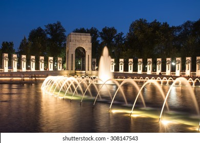 Landmark World War II Memorial fountains at the National Mall in Washington DC seen at night.