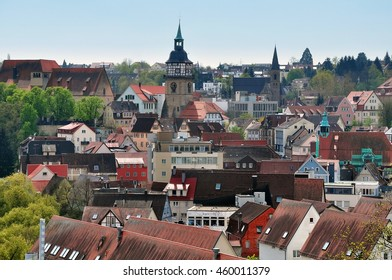 Landmarks of Backnang, Baden-Wurttemberg, Germany. Panoramic view of  half-timbered houses with red tiled roofs and a church.