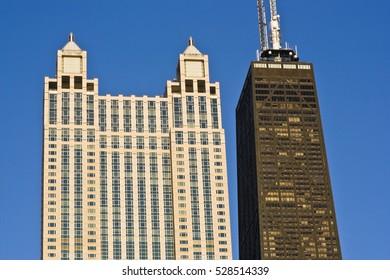 Landmarks of Downtown Chicago against blue sky.