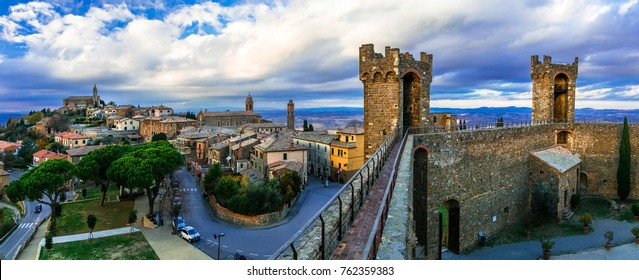 Landmarks of Italy - medieval town Montalcino over sunset, famous wine region in Tuscany