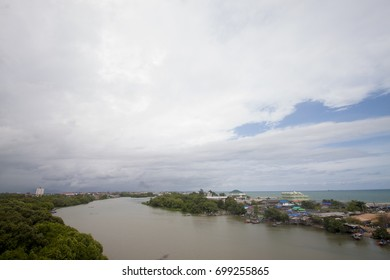 Landmarks of Pak-Nam river can see Mangrove forest and city near beach.with white cloud and on blur sky in Rayong Thailand.