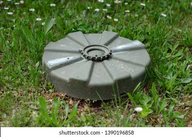 Landmine on the grass. Around the world, there are an estimated 110 million land-mines still lodged in the ground